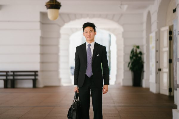a business man in a suit with a suitcase, highlighting new business opportunities